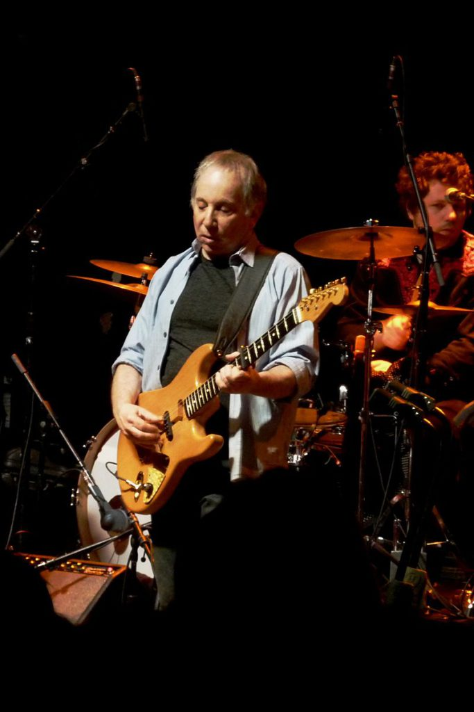 Paul Simon uses a capo