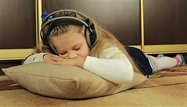 Sleeping girl with headphones