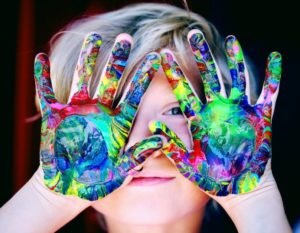kid with hands of colors