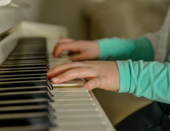 kid playing piano