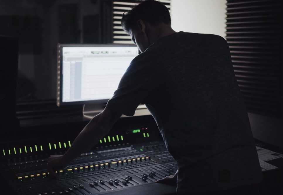 engineer bending over a mix