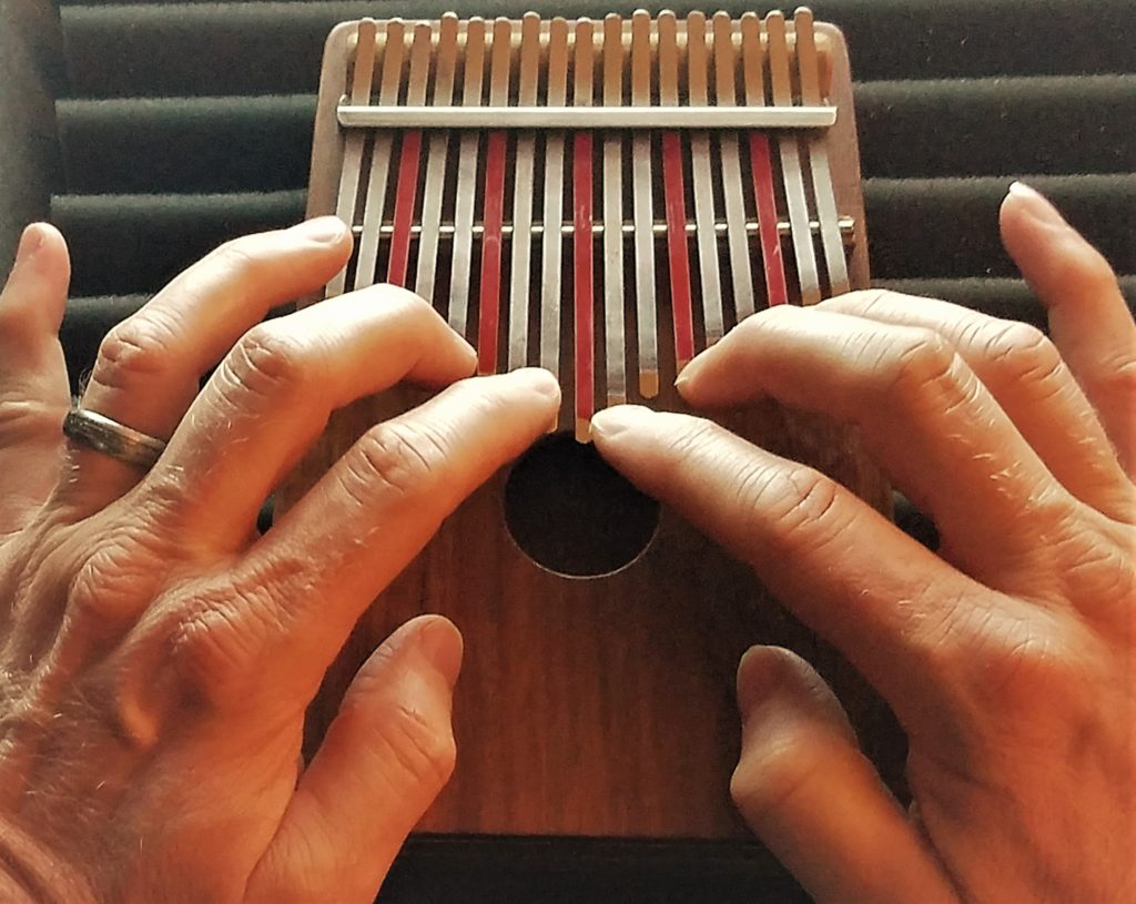 finger playing the Kalimba