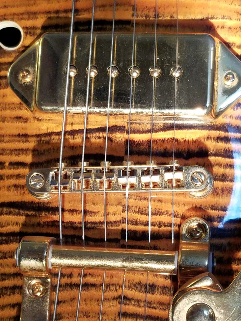 Open guitar strings from middle