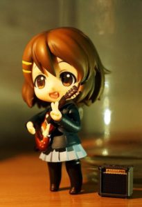 doll plays guitar