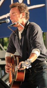 Bruce Springsteen playing Takamine