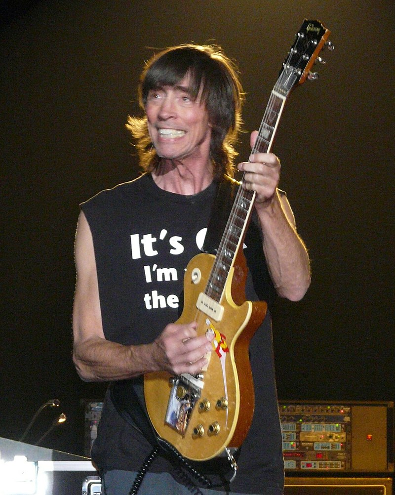 Tom Scholz playing a guitar solo